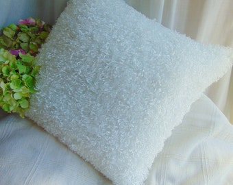 Pure white glossy curly fur pillow