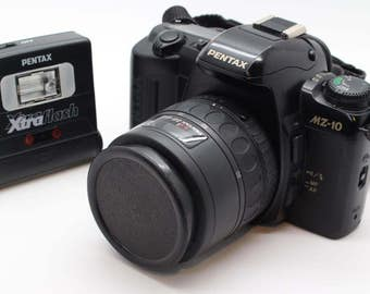 Pentax MZ-10 35mm SLR Camera with 35-80mm Autofocus lens, flash unit, filter, manual, remote flash and neck strap – VGC and tested