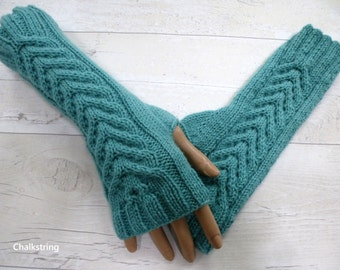 Hand knitted longer length aqua wristwarmers with cables. Fingerless gloves