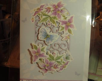 A Handmade card with a Butterfly and Flowers