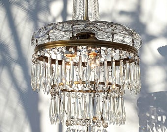 A very rare 1920s beautiful wedding cake chandelier with a crystal cut glass top