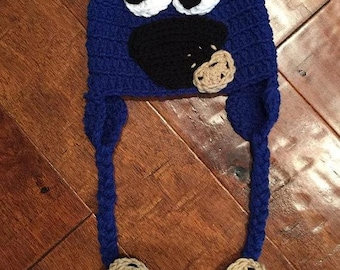 Crocheted Cookie Monster hat with ear flaps and braids