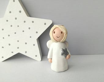 Little pottery angel, ceramic white ornament, little angel with silver glitter star