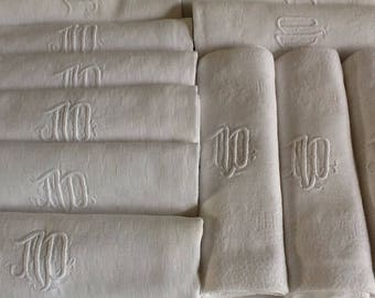 12 vintage french damask cotton napkins with M D or M P monogram. Set of 12 very white napkins, serviettes with hand embroidered monogram.