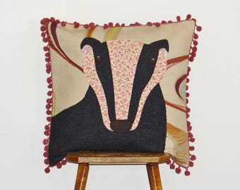 Badger cushion cover appliqued using a variety of fabrics and trimmed with pompoms