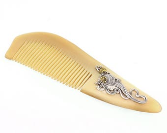 "Horn comb inlaid with silver ""Beauty"""