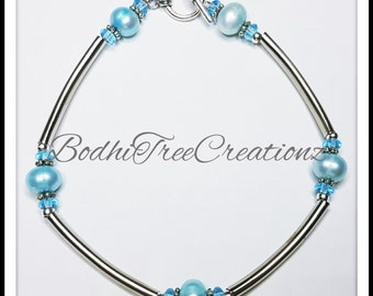 Freshwater pearls in blue and silver