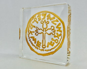 Crystal ancient coin sculptures with golden hue highlights.