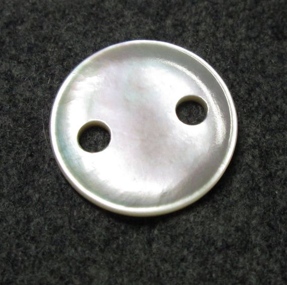 Large hole carved vintage mop button medium from