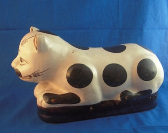 Antique Chinese pottery cat pillow with brown spots on white ground, expressive face, classic Asian item for collector or decorator