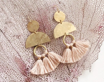 Brass cutout shape earrings with pale pink tassels