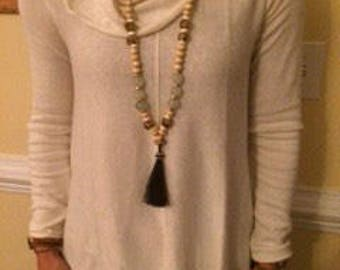 Black horse tail tassel necklace with pale aqua seaglass