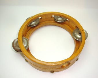 "Tambourine in need of a new skin. All 7 tacks are there. 6.5"" outside diameter of the wooden ring. Single row zils. 1.75"" deep"