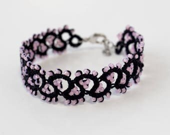 Lace bracelet with little beads made with needle tatting technique