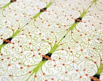 Handmade origami paper - Green spirals on pale green