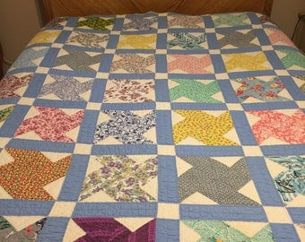 Vintage hand sewn, hand Quilted, patchwork quilt with cotton and feedsack fabric. Light weight