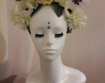 White floral headdress with butterflies