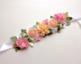 Felt flower crown with green leaves headband - pink, peach, and white with hints of gold and blue