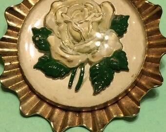 Vintage gold toned metal glass floral carved dome brooch