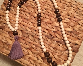 Cream and dark brown wooden beaded necklace with purple tassel