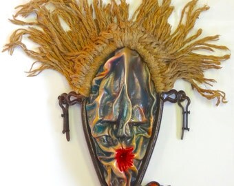 PUCKER, antique found object, wet molded leather wall sculpture, mixed media, contemporary art