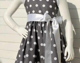 Grey dress with dots and white kids belt