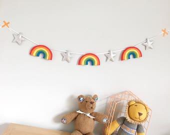 A felt rainbow and star garland