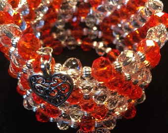 Orange, crystal and silver memory wire bracelet with heart charms