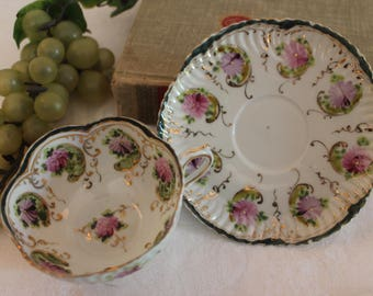 Antique White Porcelain Tea Cup and Matching Saucer - Hand Painted Purple Flowers and Gold Accents