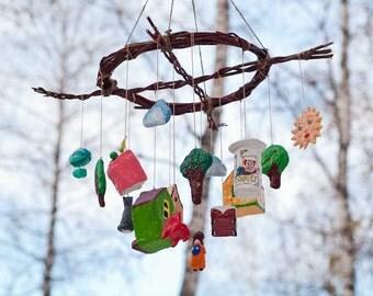 Paper mache baby crib mobile