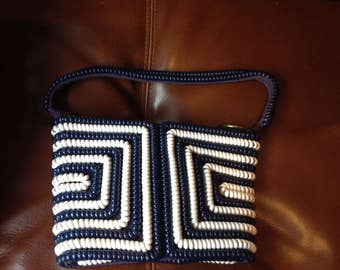 Vintage navy blue & white telephone cord purse with different designs front and back