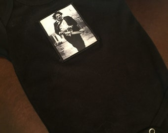 Black cotton baby onesie with adroable leatherface patch