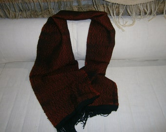 Red and black scarf woven by hand
