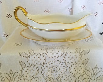 Vintage Pope Gosser gravy boat with underplate.  Off white with gold stripes.
