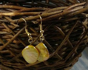 Yellow mother of pearl earrings.