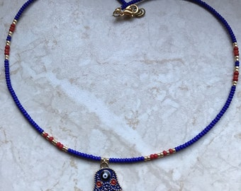 Fatimas hamsa hand in blue red evil eye nazar