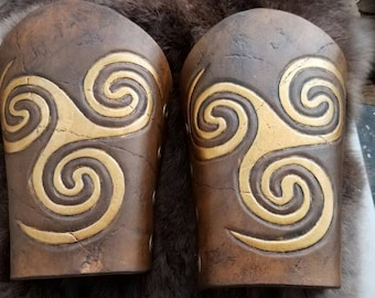 Leather bracers with tooled Celtic swirl