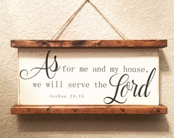 Scroll-framed wooden sign with scripture