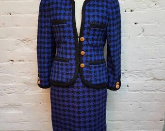Vintage blue and black patterned 1980s power suit, 4 pockets on jacket, metal buttons and shoulder pads UK size 8/10.