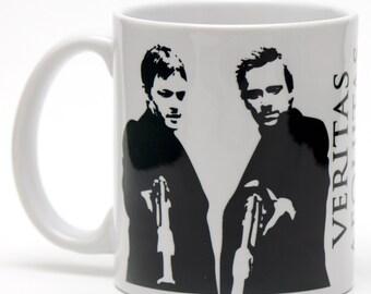 The Boondock Saints Veritas Aequitas 11oz ceramic mug.