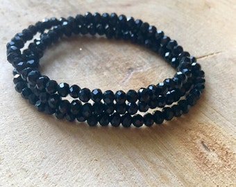 Wrap bracelet of shiny black faceted beads