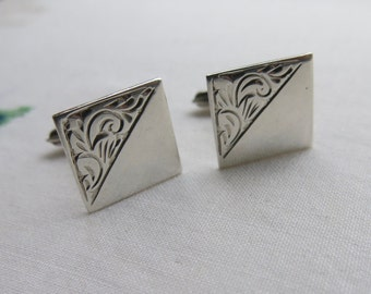 Square silver cufflinks with engraved foliage pattern