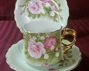 Lefton china cup and 2 saucers
