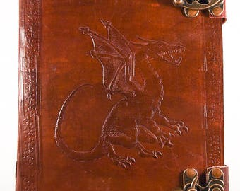 Leather journal with embossed dragon and handmade paper.