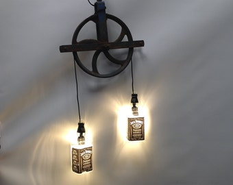 Vintage Pulley Light with repurposed Jack Daniel's bottles, barn yard steel pulley, with LED Edison-style bulbs