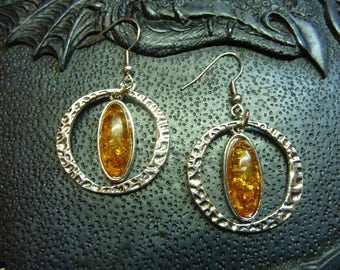 Buckles(Loops) of medieval elvish ear with orange yellow synthetic hammered and amber ring