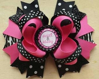 Boutique hair bow with a bottle cap center