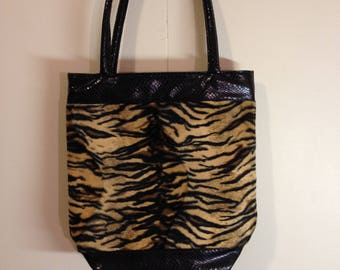 Faux leather and animal print hand bag