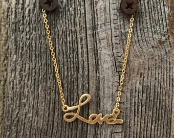 Matte gold love necklace