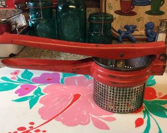 Red ricer / potato masher / fruit juicer